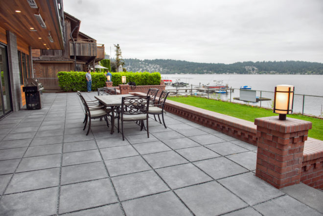 24 x 24 Vancouver Bay Architectural Slabs bordered by  an Inca brick seating wall